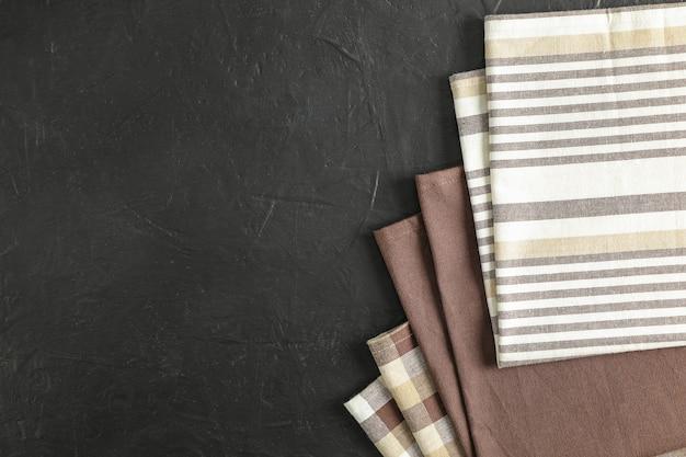 Fabric napkins on black background