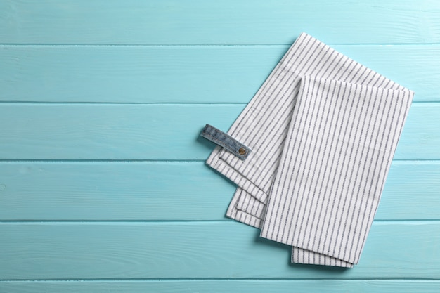 Fabric napkins on color background, space for text