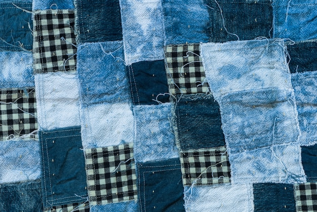 Fabric patchwork background and texture, thread of old fabric blue tone for background