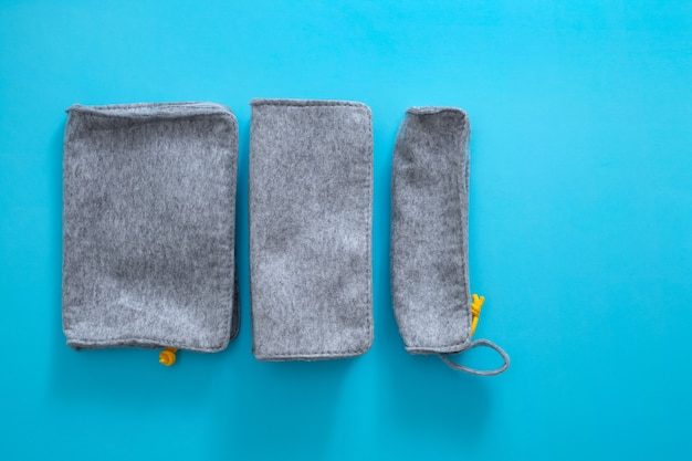 Fabric pencil cases on blue background