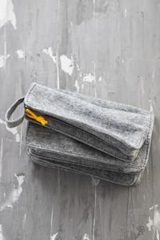Fabric pencil cases on ceramic background