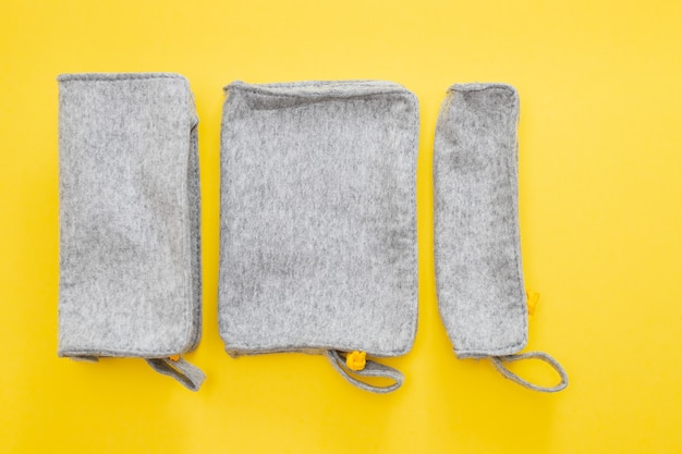 Fabric pencil cases on yellow background