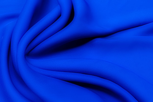Fabric rayon. the color is blue. texture, background, pattern.