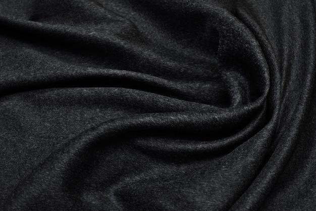 ウールの生地スーツブラックストレッチ。