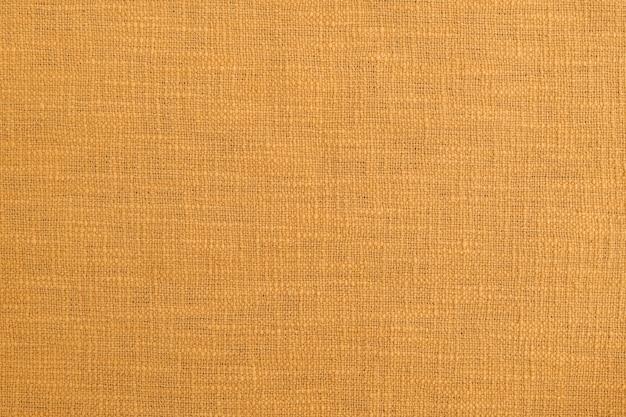 生地の質感の背景の壁紙、オレンジ色の自然な色合い