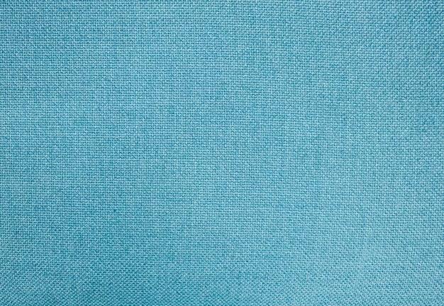 Текстура ткани, крупным планом голубой фон ткани из хлопчатобумажной ткани в пастельных тонах