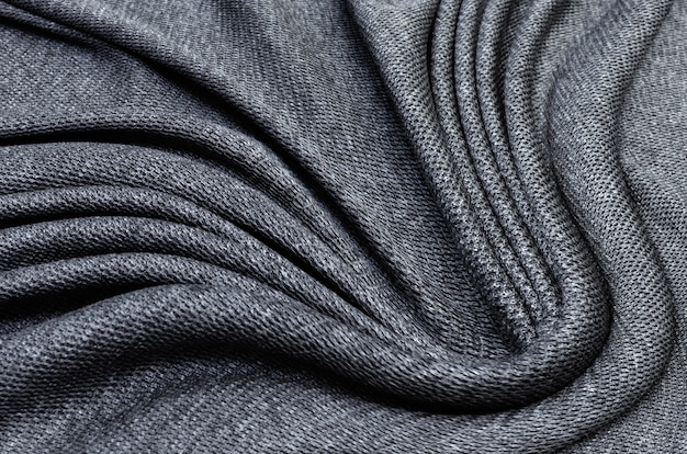 Текстура ткани, крупным планом текстуры черной ткани или джерси для фона веб-дизайна