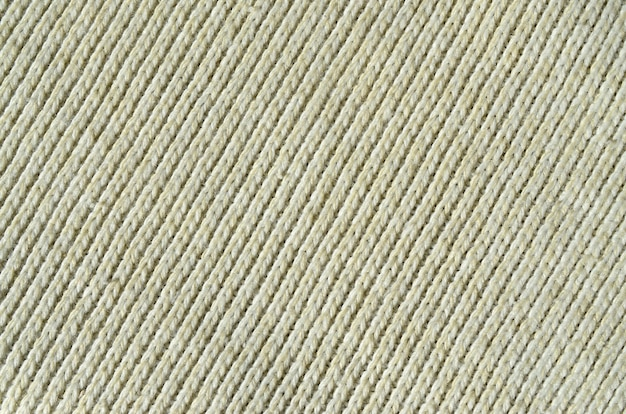 Fabric texture of a soft yellow knitted sweater