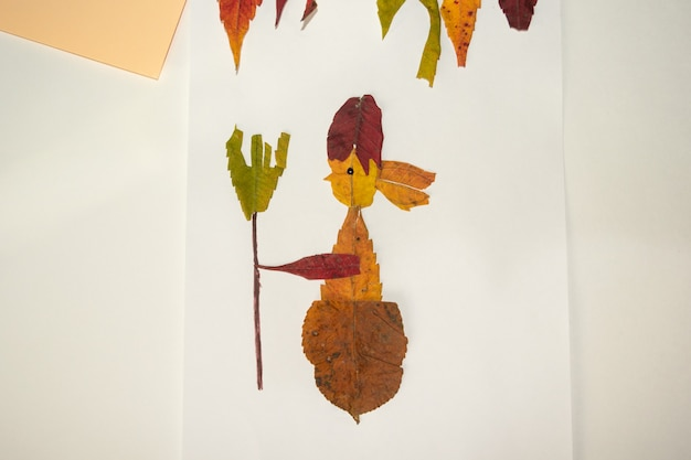 Fabulous character baba yaga from dry leaves. craft application in autumn.