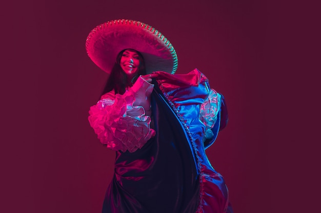 Fabulous cinco de mayo female dancer on purple  in neon light