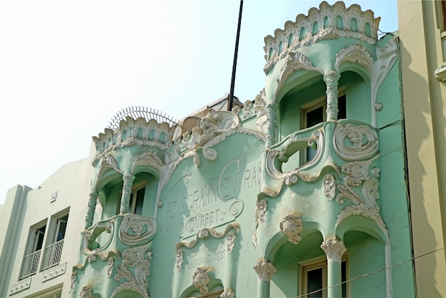 Facade of casa courret, a gorgeous pastel green and white art nouveau building in downtown lima, peru