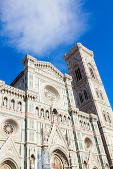 Facade of cathedral church santa maria del fiore with towerbell close up, florence, italy