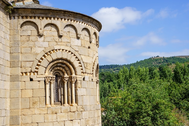 Facade of a medieval stone castle with arches on it and the mountain on the background. villefranche de conflent in france