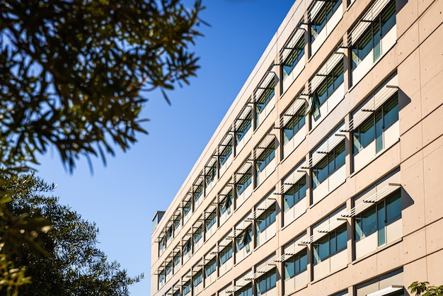 Facade of a modern building illuminated by the sun
