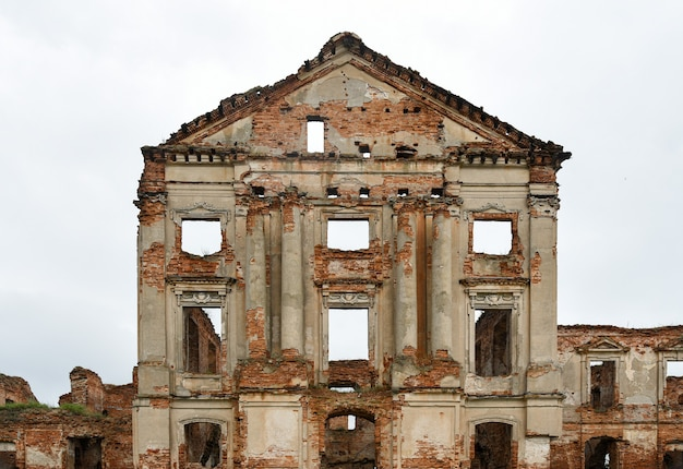 Facade of an old ruined palace.