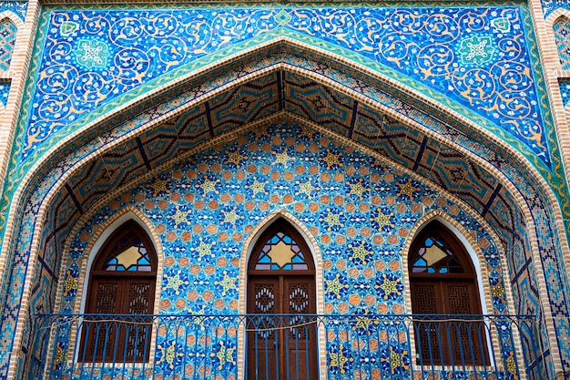 The facade of the old turkish bath building is lined with mosaics