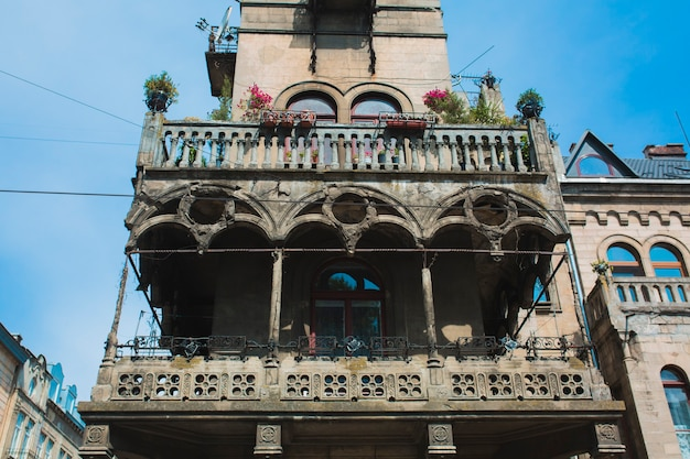 Facade of residential building with a balcony and wondows in the center of lviv, ukraine