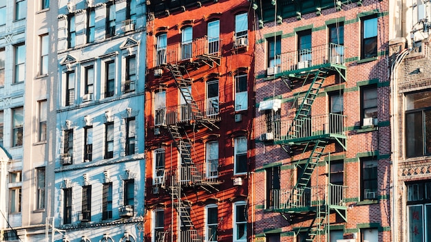 Facades of building with fire escapes