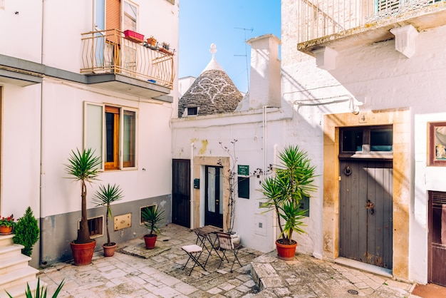 Facades of old italian mediterranean houses in bari painted in colors.