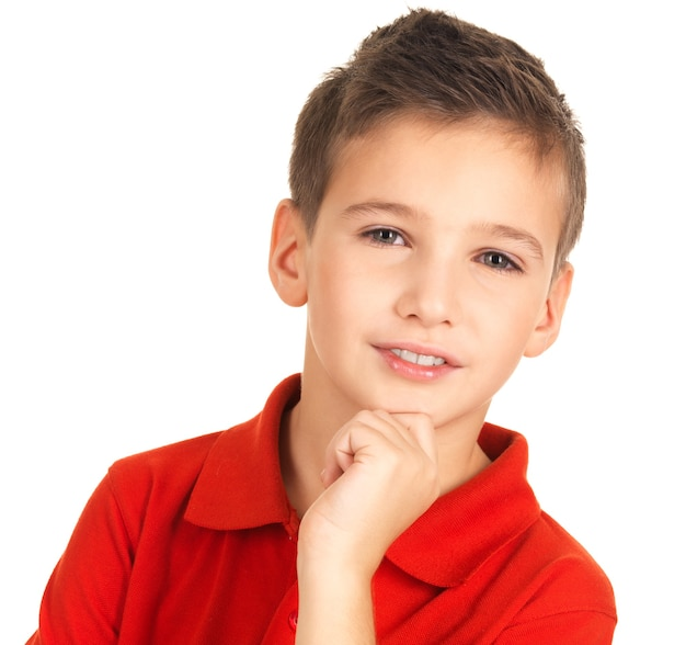 Face of adorable young smiling boy isolated on white