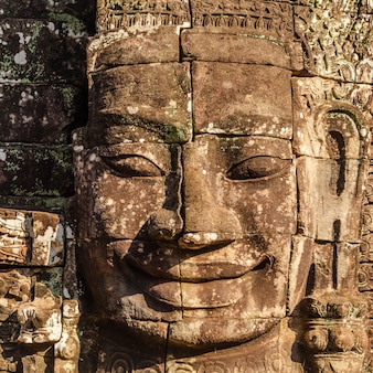 Face of bayon, the ancient castle in cambodia