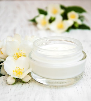 Face and body cream moisturizers with jasmine flowers