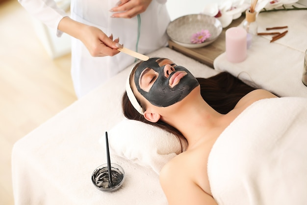 Face care session at the spa center with a beautiful woman.