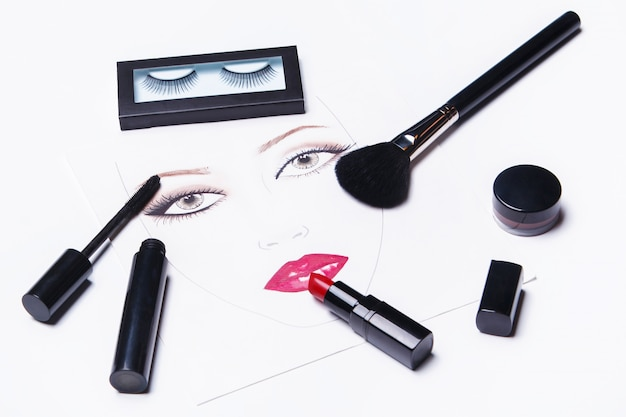 Face chart and different makeup objects and cosmetics