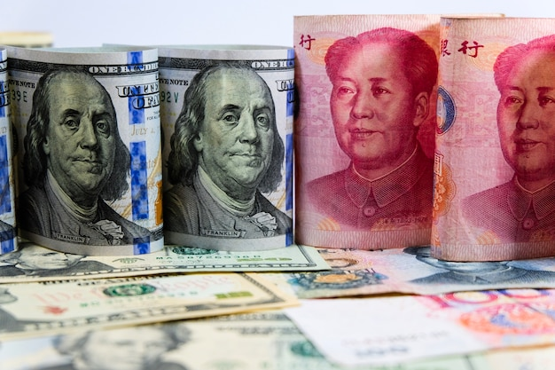 Face to face of dollar and yuan banknotes for the biggest economic country in the world.