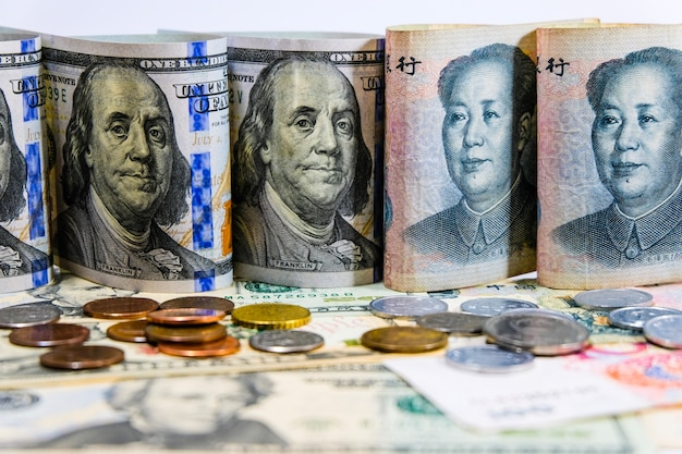 Face to face of dollar and yuan banknotes