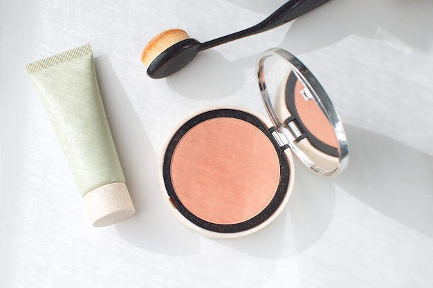 Face foundation green tube pressed powder blush brush