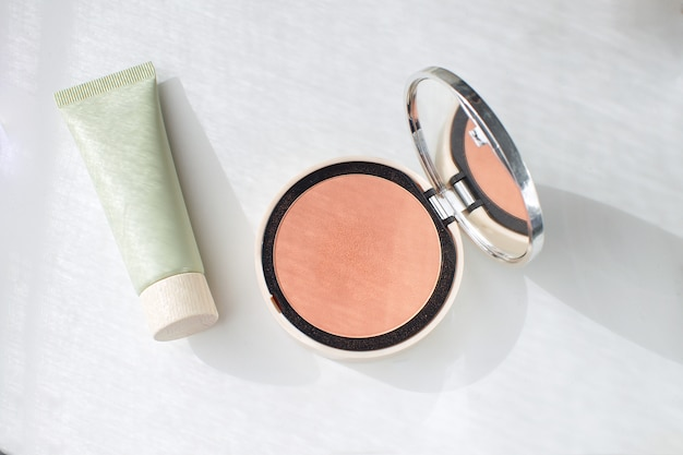 Face foundation green tube pressed powder blush