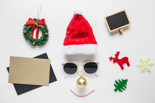 Face from santa hat and sunglasses with small toys