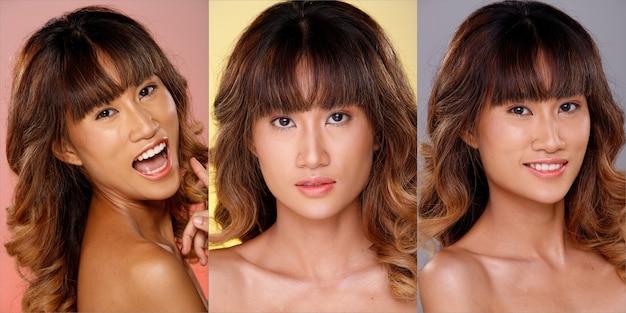 20代のアジア人女性の顔のヘッドショットの肖像画日焼けした肌茶色のブロンドの髪のスタイル化粧品メイク。女の子はピンク、黄色、灰色の背景に分離された感じのポーズを表現します