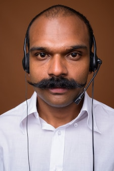 Face of indian businessman with mustache as call center representative