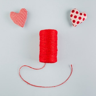 Face made from hearts and rope roll