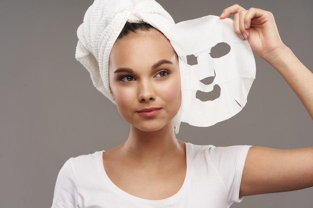 Face mask towel on the head of a beautiful girl