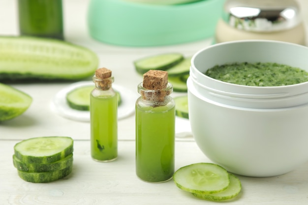 Face mask with cucumber. cosmetics with cucumber extract on a white wooden table. spa. beauty.