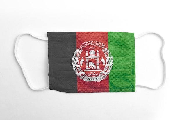 Face mask with printed afghanistan flag, on white background, isolated.