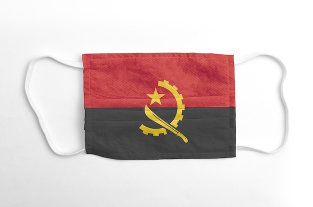 Face mask with printed angola flag, on white background, isolated.