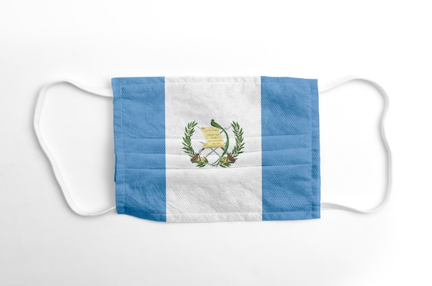 Face mask with printed guatemala flag, on white background, isolated.
