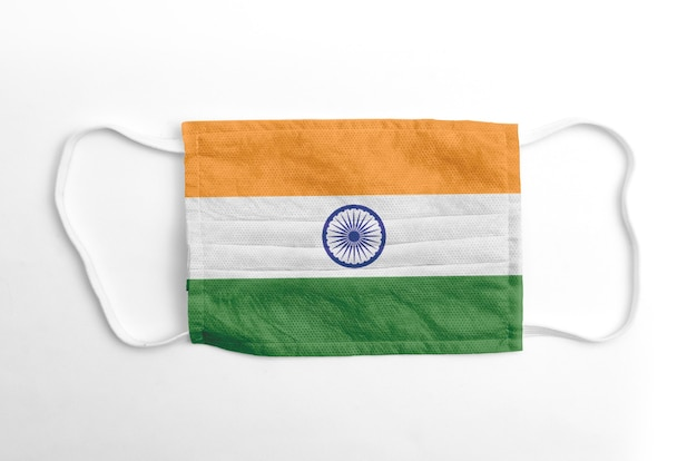 Face mask with printed india flag, on white.