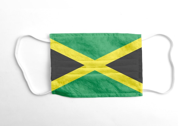 Face mask with printed jamaica flag, on white background, isolated.