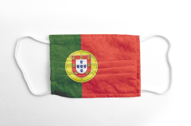 Face mask with printed portugal flag, on white background, isolated.