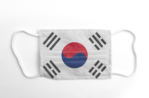 Face mask with printed south korea flag, on white.