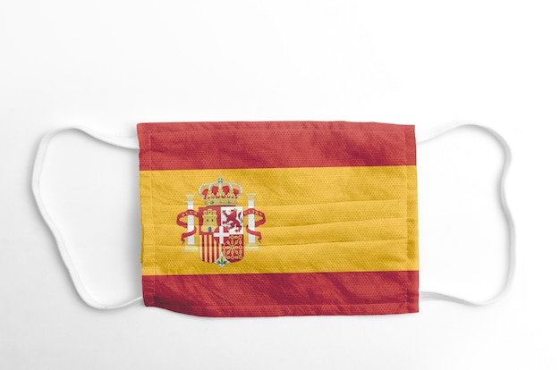 Face mask with printed spain flag, on white.