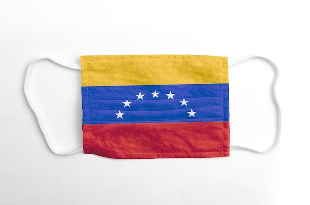 Face mask with printed venezuela flag, on white background, isolated.