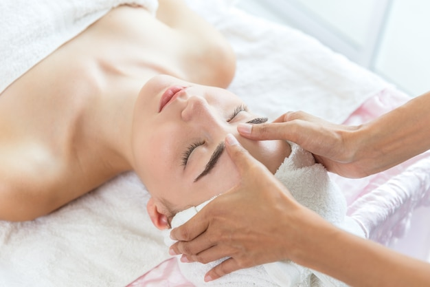 Face massage body skin care in health and spa service