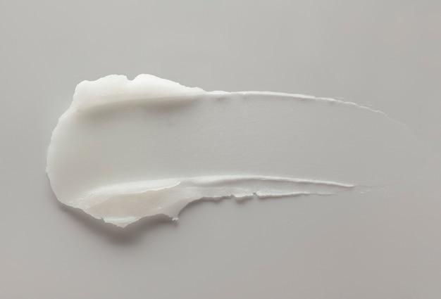 顔またはボディクリームヘアバームまたはバームグリーンセージの背景