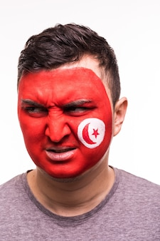 Face portrait of happy fan support tunisia national team with painted face isolated on white background